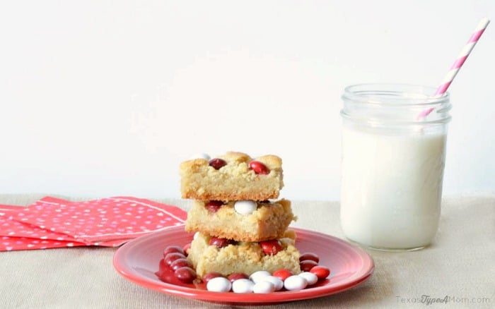 M&M's Red Velvet Sugar Cookie Bars recipe. The perfect dessert for Valentine's Day or anytime!