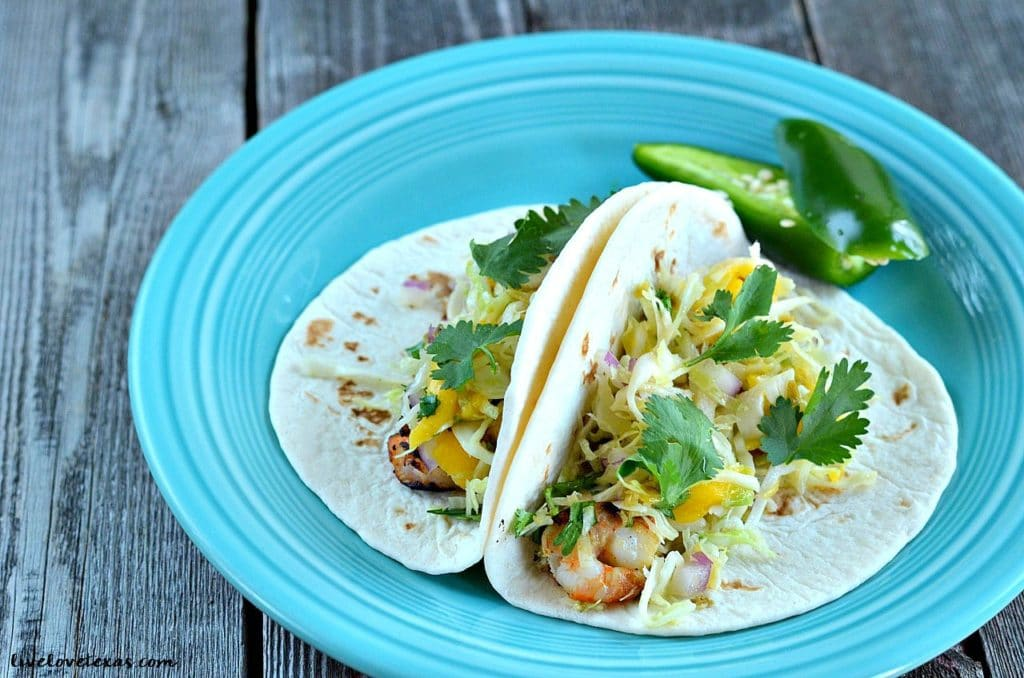 These Grilled Shrimp Tacos with Jalapeno Mango Slaw are fresh and flavorful with just the slightest kick. Perfect for Cinco de Mayo!