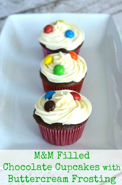 M&M Filled Chocolate Cupcakes with Buttercream Frosting Topped with M&Ms #shop #BakingIdeas #cbias