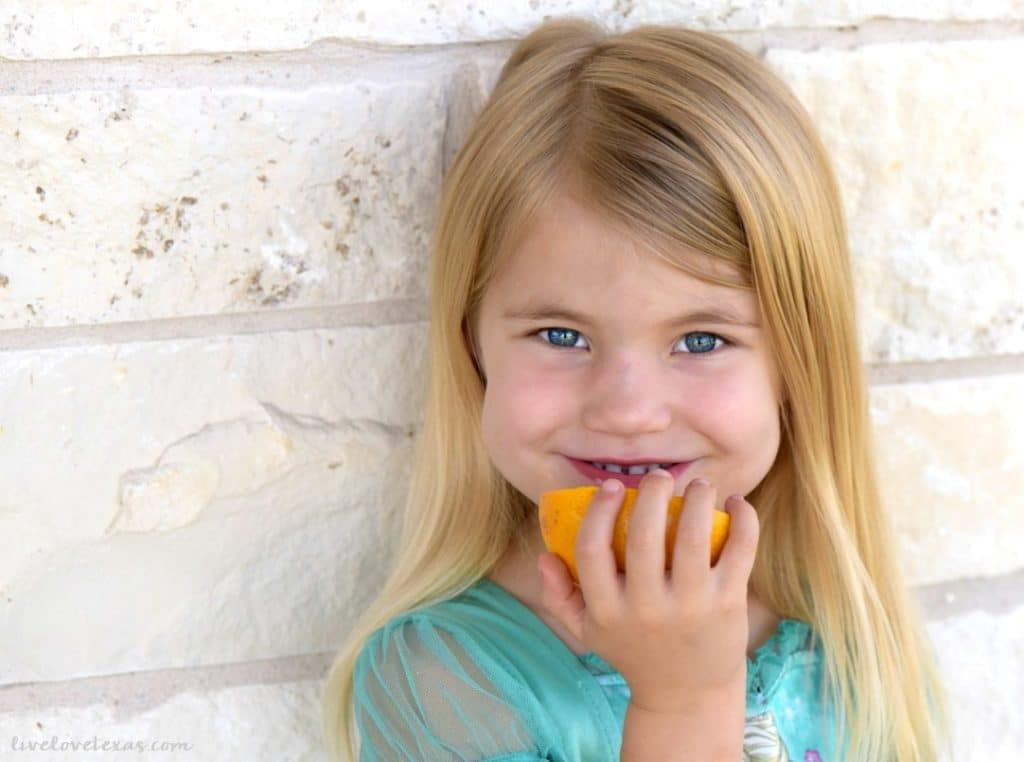 Girl eating grapefruit