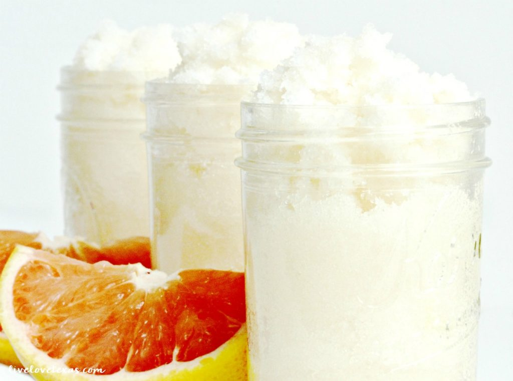 diy grapefruit sugar scrub in jars with fresh pink grapefruit