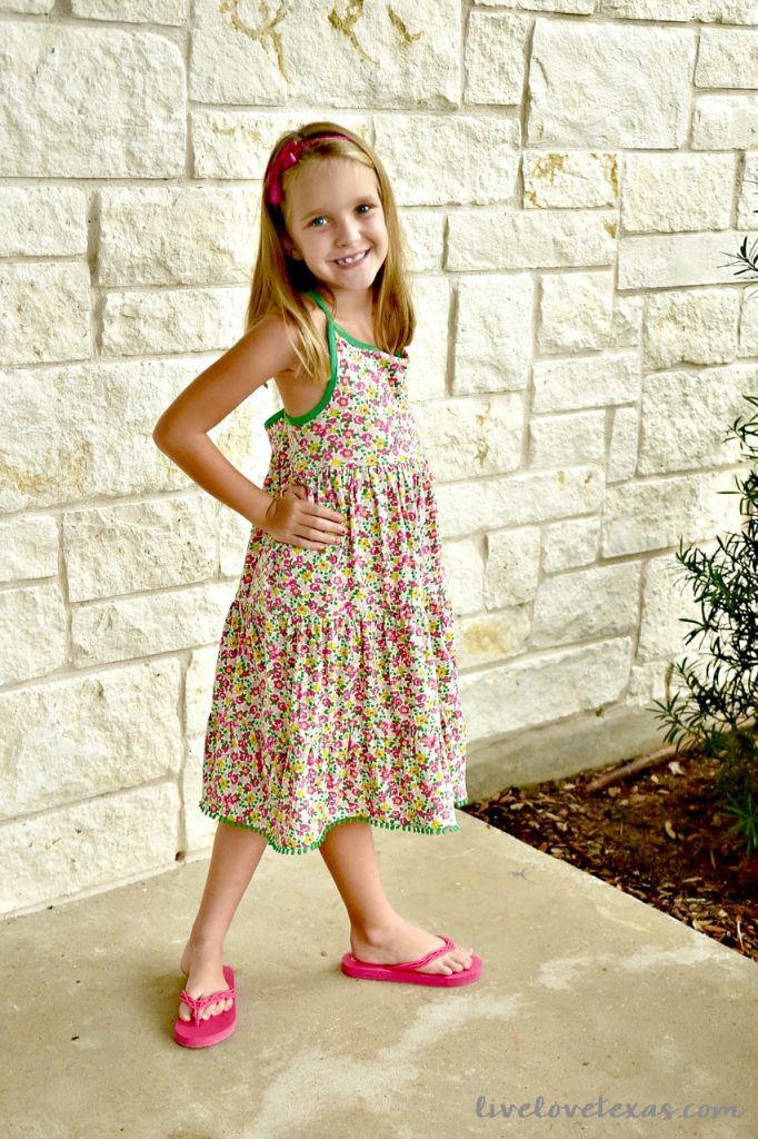 7 year old wearing Mini Boden Floral Dress