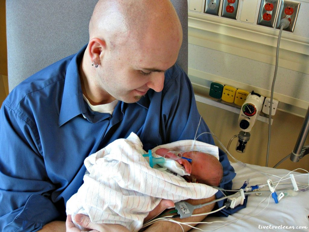 father-holding-baby-in-nicu