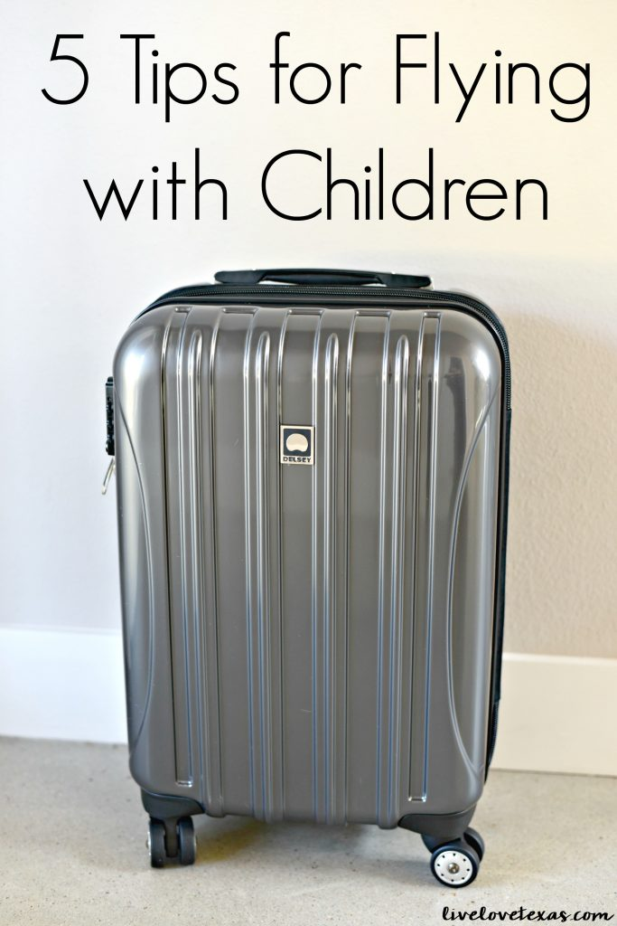 Traveling with kids doesn't have to be scary. Check out these 5 Tips for Flying with Children!