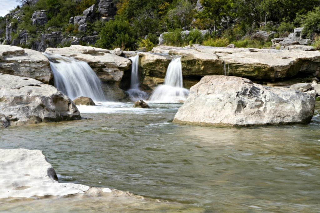 You don't have to travel far to cool down this summer with this collection of the 9 Best Central Texas Waterfalls located within an hour of the greater Austin area. City parks, state parks, and everything in between!