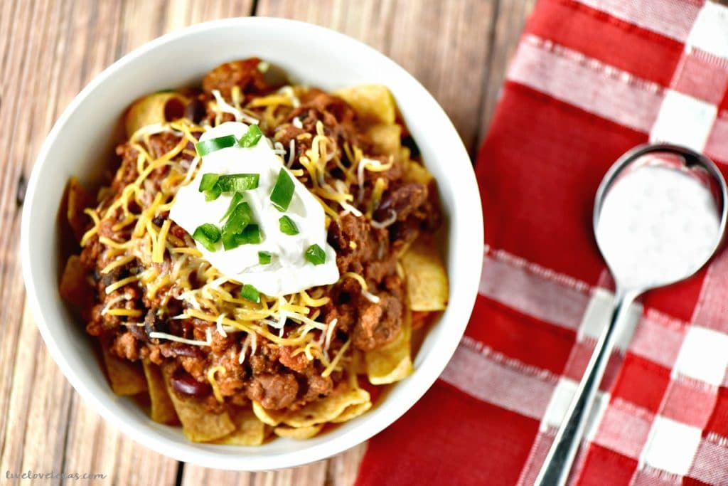 If you need a midweek family or weekend tailgating feast inspiration, this Easy Chili Recipe with Ground Beef in the Slow Cooker is perfect for both! Plus, Frito Pie recipe!