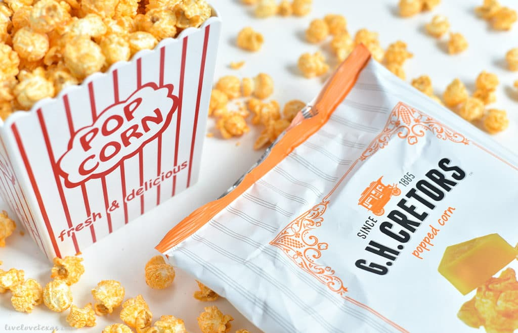 popcorn bucket with popcorn bag spilled