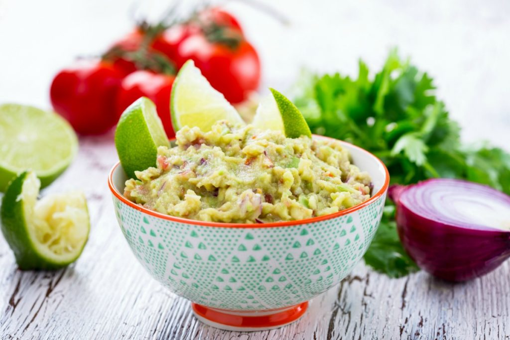 This is the very best homemade guacamole recipe you'll find. Avocados, tomatoes, onions, peppers, cilantro, and lime magically come together to form a guacamole recipe easy and quick dip perfect for any Mexican recipe. If you're looking for a guac recipe that's better than restaurants and will leave you licking the bowl, this is the one for you!