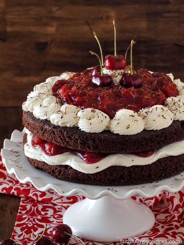 Flourless Black Forest Cake with whipped cream and fresh cherries.