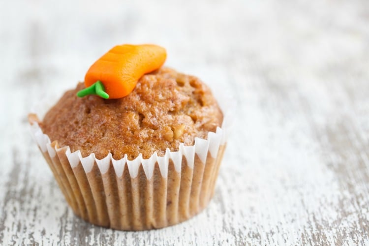 Kid friendly carrot muffin with carrot icing on top.