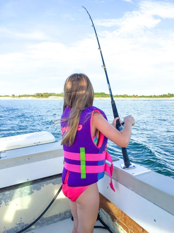 Water Safety: Girl Fishing in Life Vest on Boat