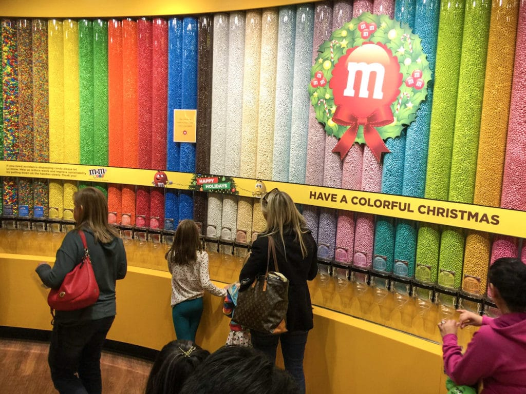 Shopping different colored candies at M&M World in Las Vegas