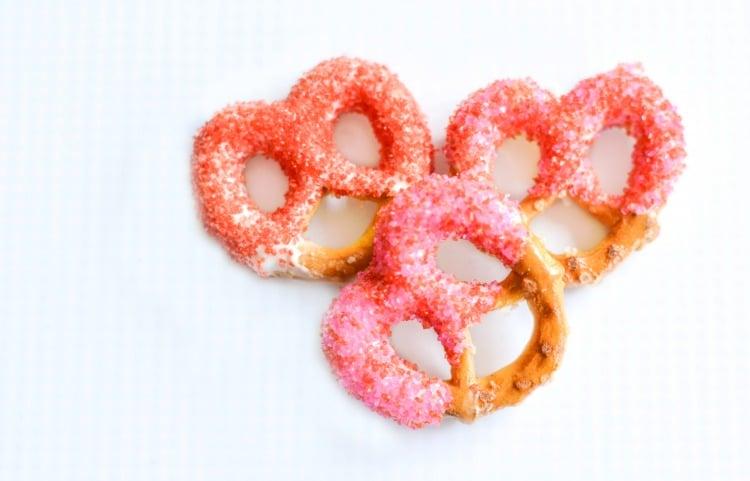 Sprinkle covered pretzels for Valentine's Day snacks.