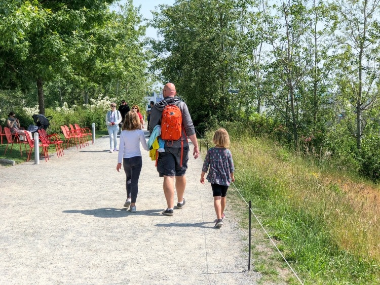 Dad and daughters walking in Sculpture Garden in Seattle, Washington
