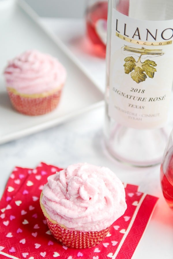 Galentine's Day set up with Rosé Wine Cupcakes and Rosé wine.