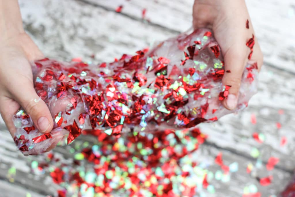 Clear slime with red confetti mixed in. Learn how to make confetti slime.