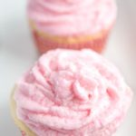Frosted Rosé wine cupcakes on plate topped with sugar