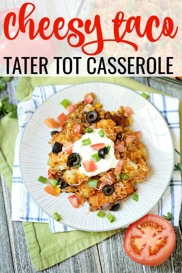 Cheesy Taco Tater Tot Casserole on kitchen towel with tomato and cilantro.