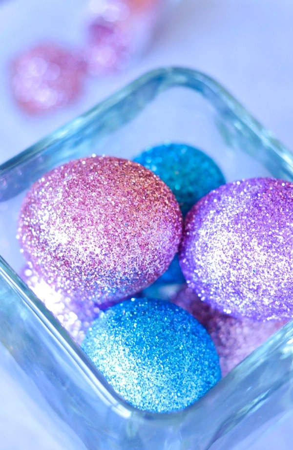 glitter decorated Easter eggs in glass jar