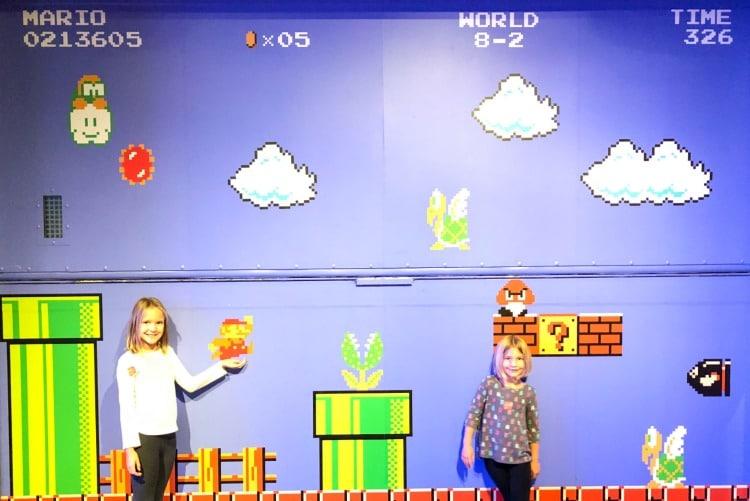 Two girls having fun in the Mopop Museum in Seattle, Washington.