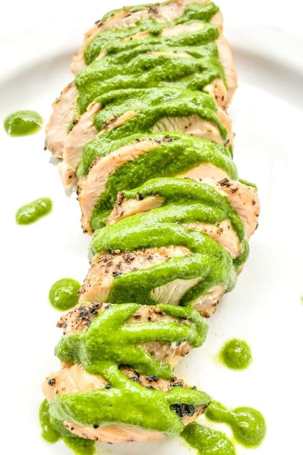 Grilled chimichurri chicken sliced and plated