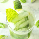 Fresh mojitos in glasses with fresh lime and mint leaves