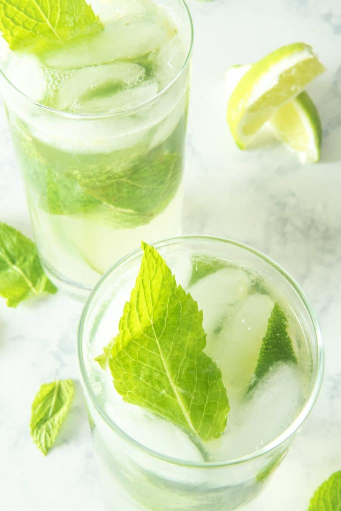 Skinny mojitos in glasses with rum, fresh lime juice, mint, and sugar free syrup