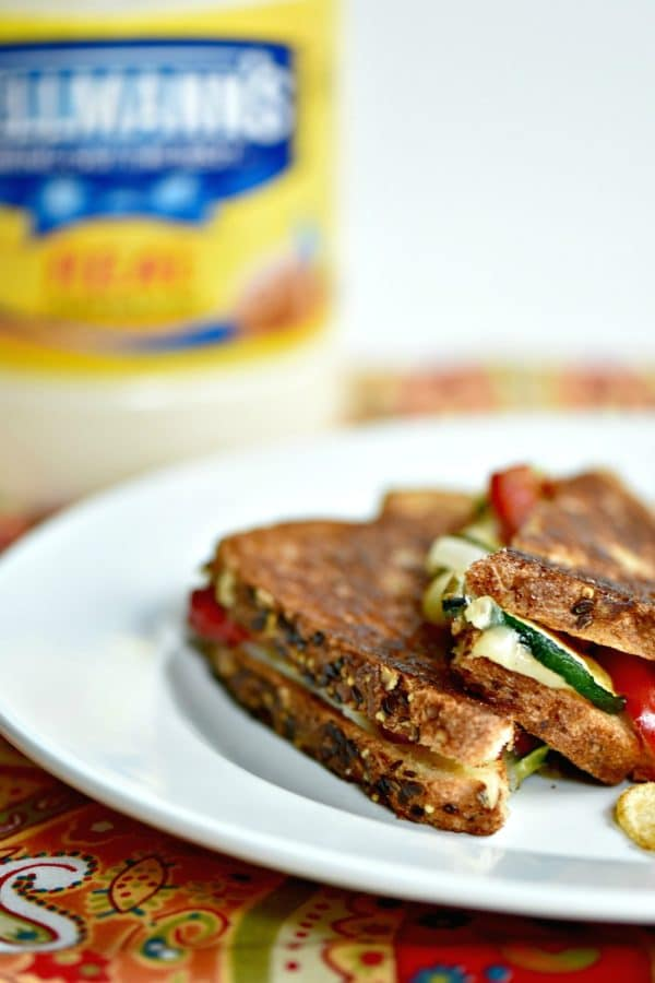 Zucchini grilled cheese sandwiches with mayo instead of butter on a plate with chips