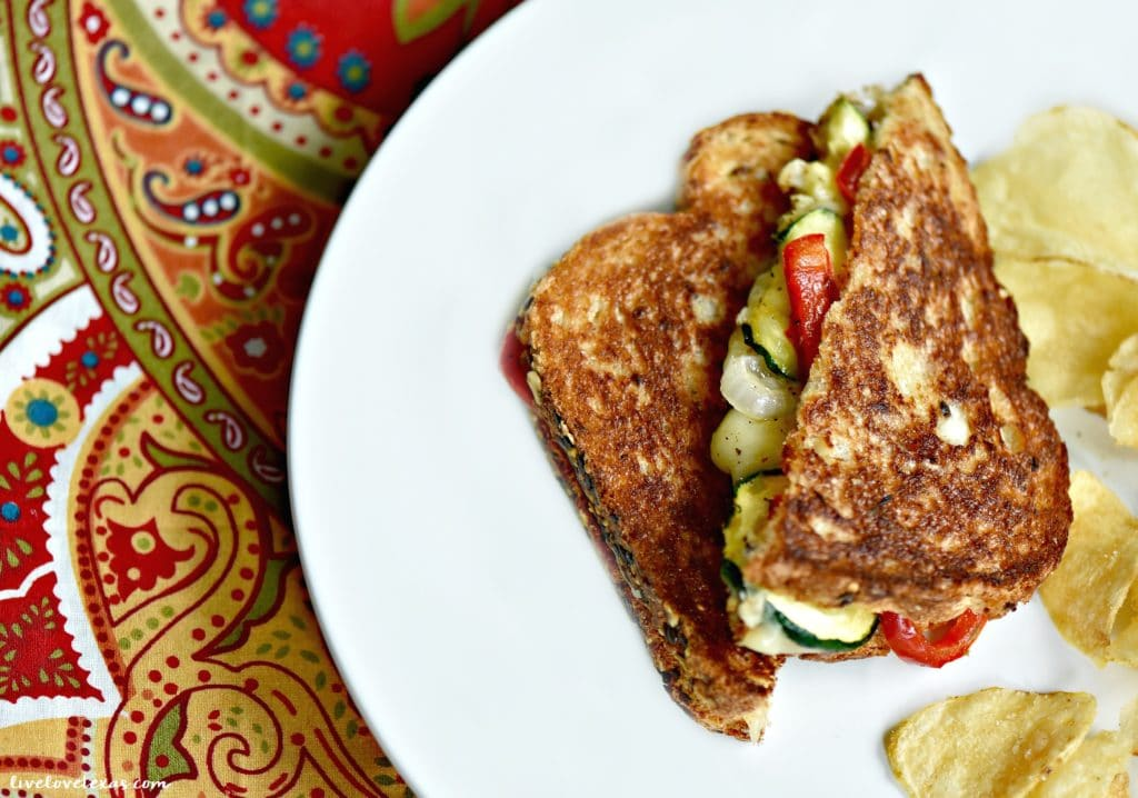 Crispy veggie filled grilled cheese sandwiches on plate