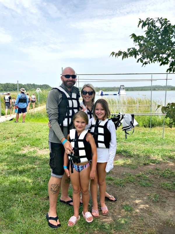 Family in life vests outside of Hero Water Sports in Bastrop Texas