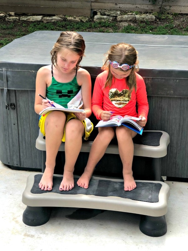 Girls reading outside to avoid summer slide