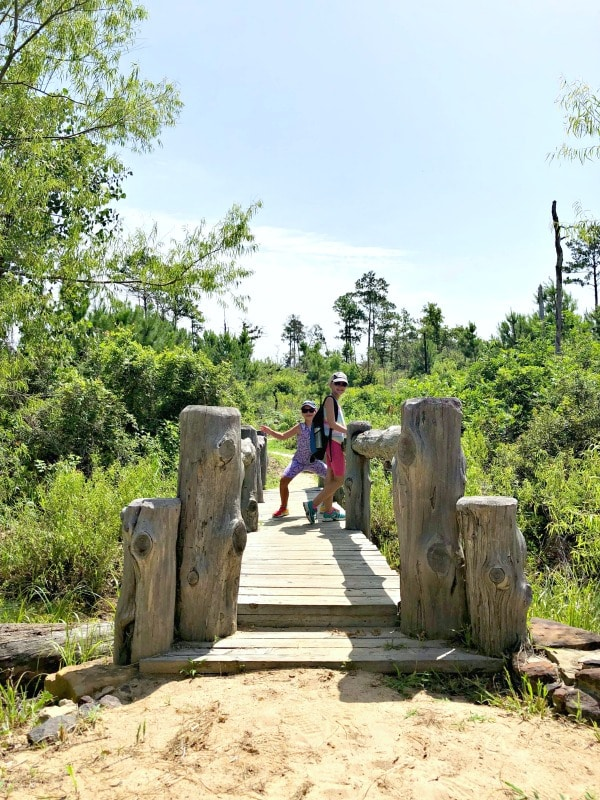 Girls posing on a bridge in Bastrop State Park