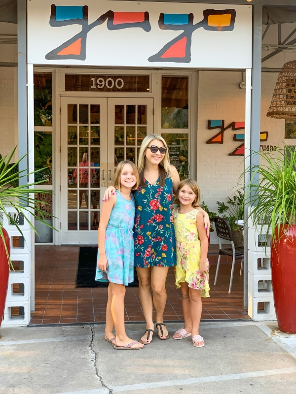 Mom and daughters standing in front of Yuyo Restaurant in Austin Texas