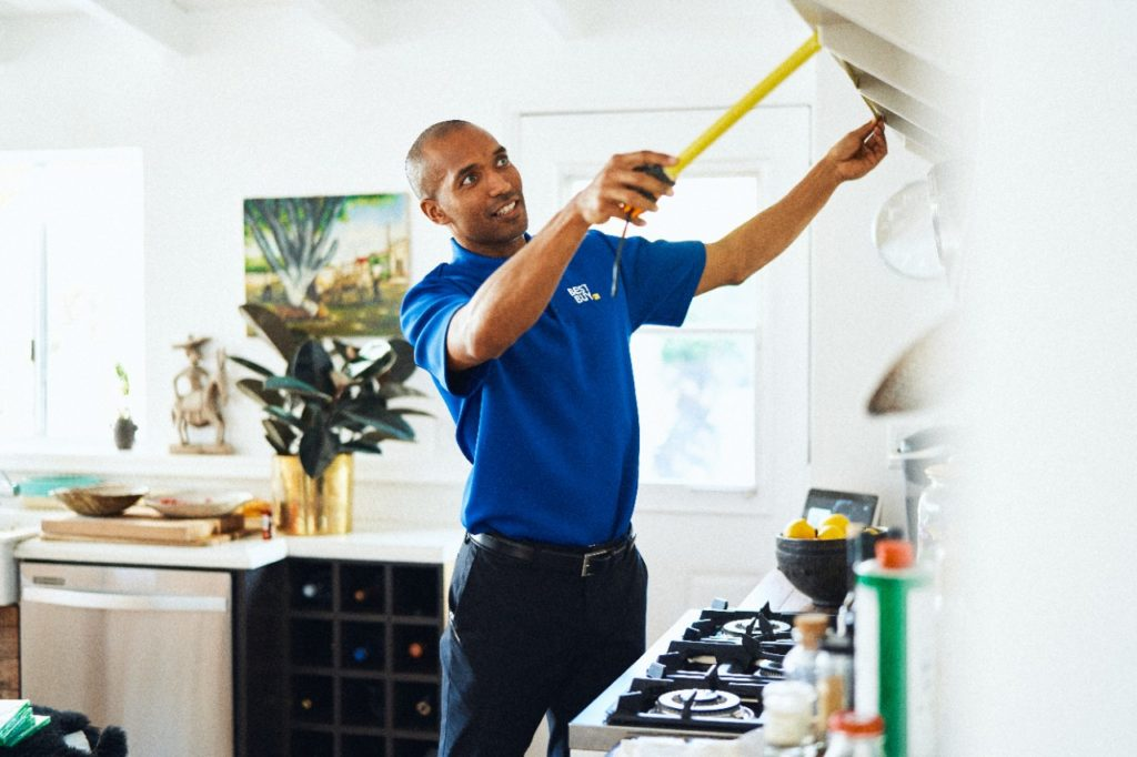 Best Buy service tech measuring home for new technology