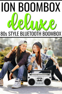 Ion Boombox Deluxe Speaker Hero with two teenage girls using bluetooth from phone to control music