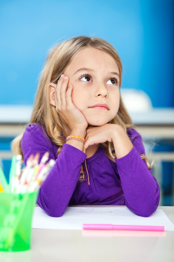 Girl with ADHD unable to focus in class.