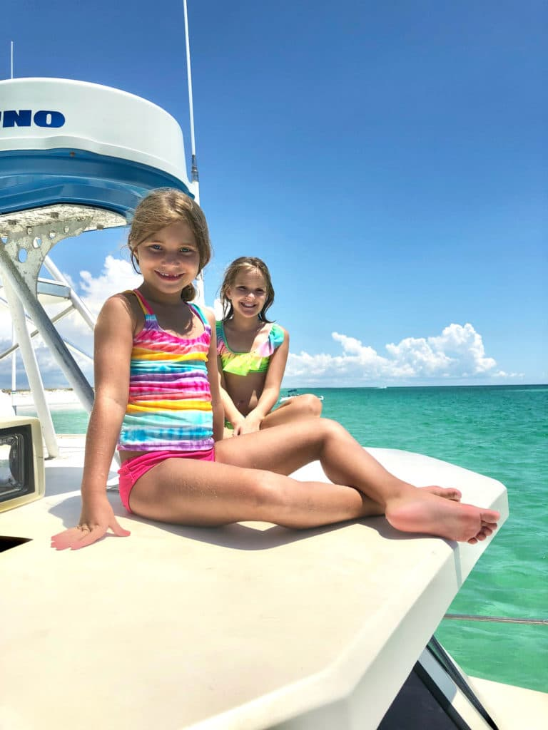 Two girls on charter boat in Panama City Beach Florida.