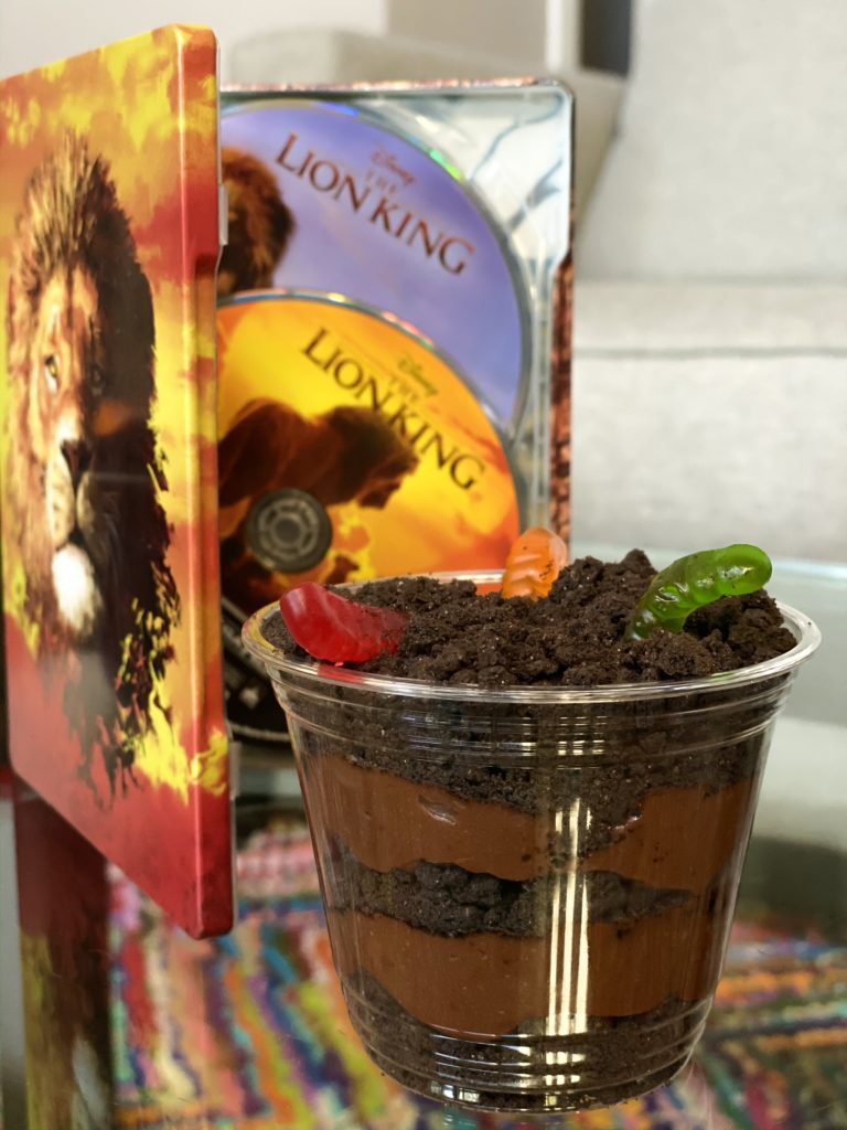 Oreo Pudding Cups with The Lion King movie in front of with colorful rug