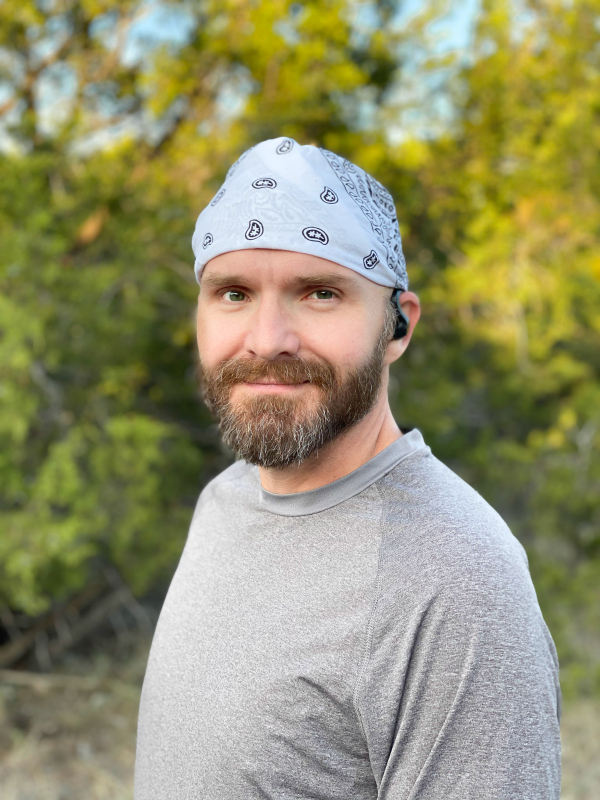 Man ready to run with wireless earbuds.