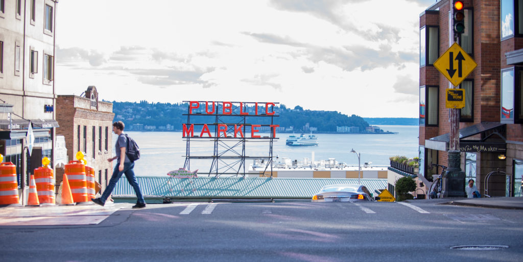 Seattle Public Market with ferry boat on bay in background