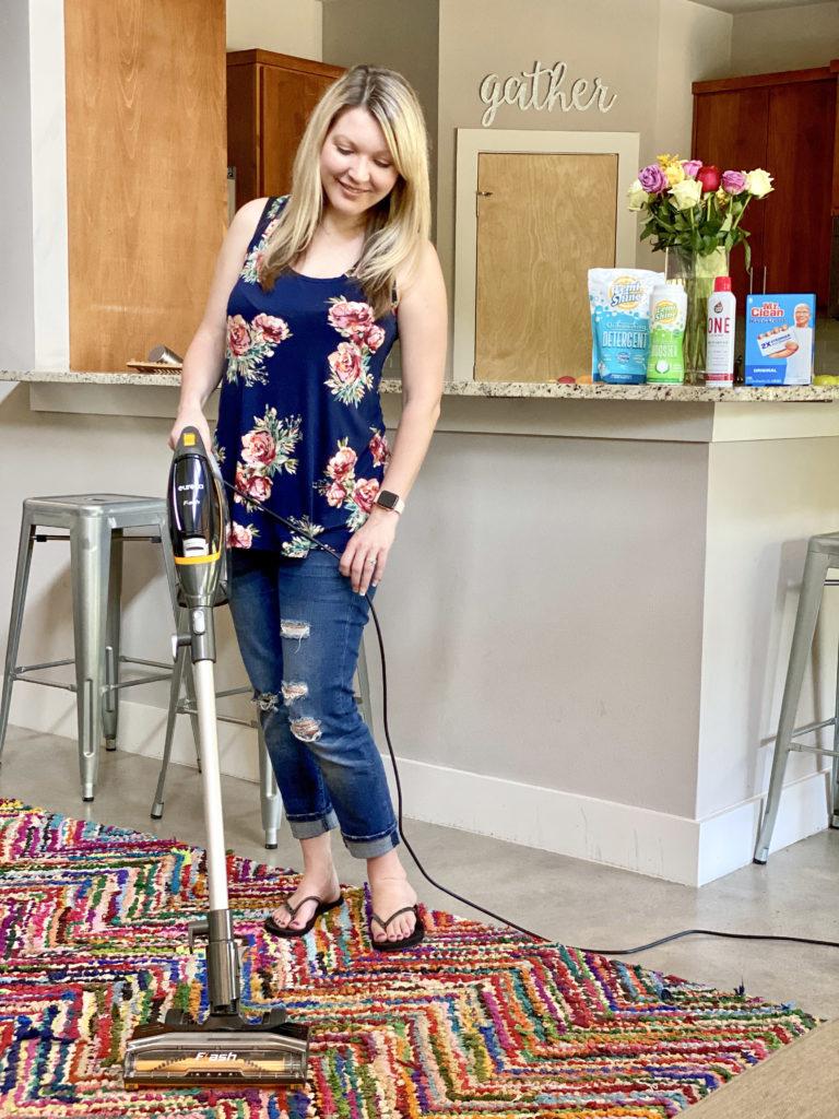 Using a lightweight Eureka Flash vacuum to rainbow rug.