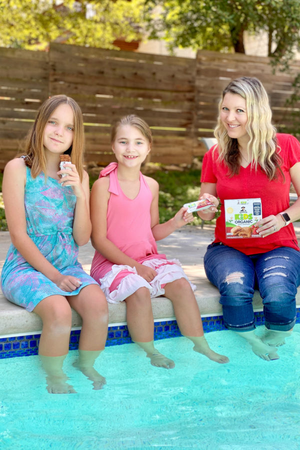 mom and girls having easy snacks by the pool