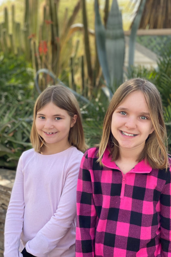 Beautiful sisters in cactus garden.