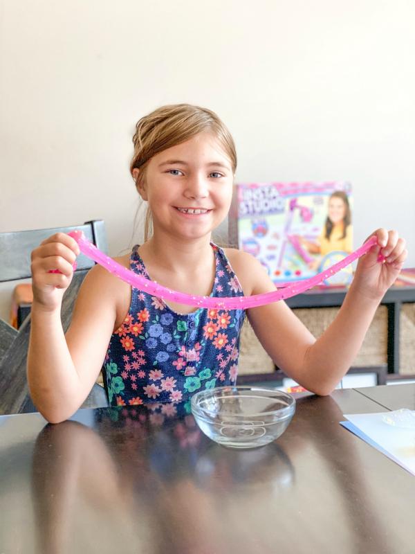 Girl playing with Instastudio Slime Kit