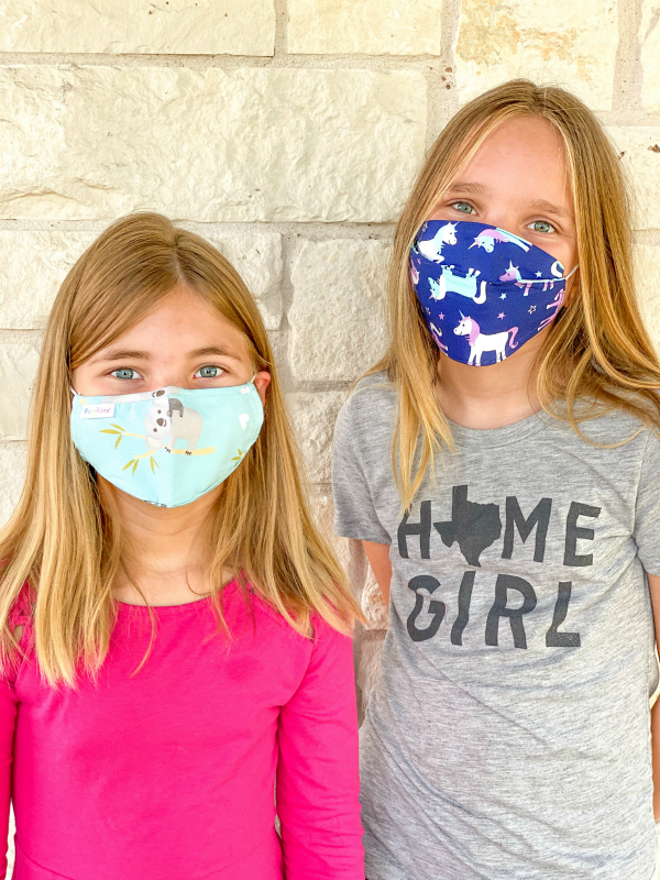 Two girls wearing Funkins face masks for back to school 2020