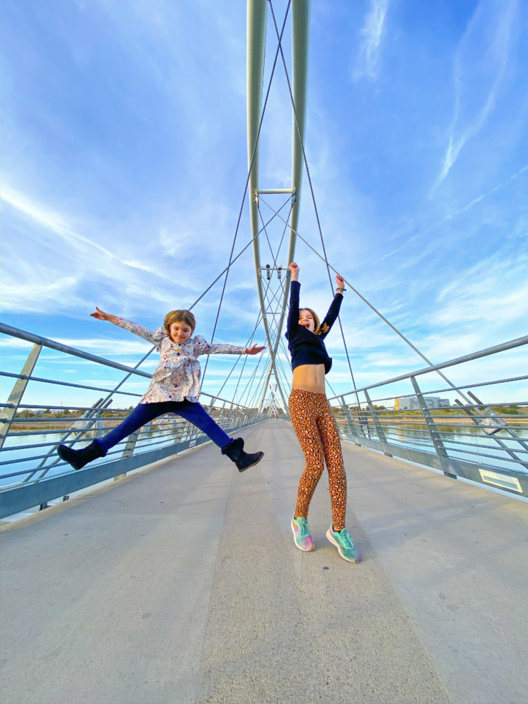 Girls Jumping on Bridge over Town Lake in Tempe Arizona