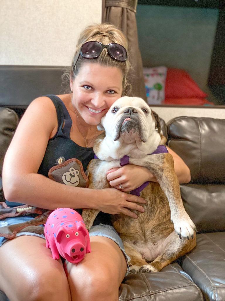 dog mom and bulldog holding dog toys
