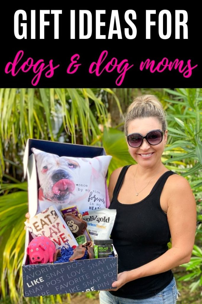 woman holding box of dog themed items with gifts ideas for dogs and dog mom text overlay