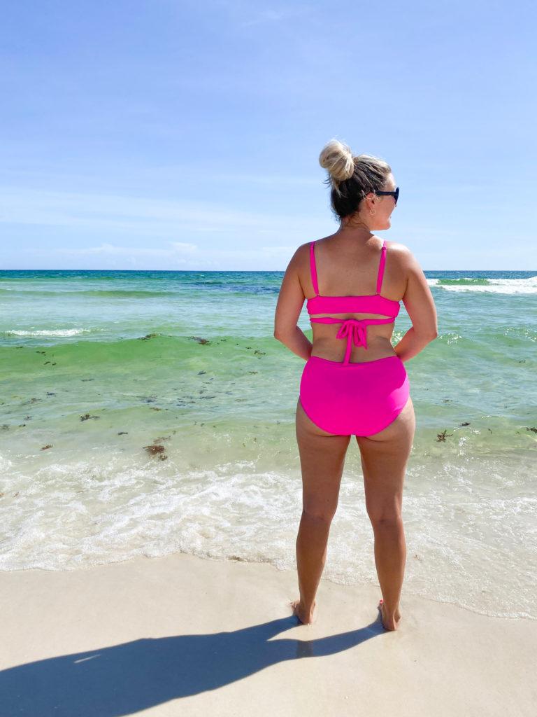 Woman in bikini after fat freezing treatment on flanks