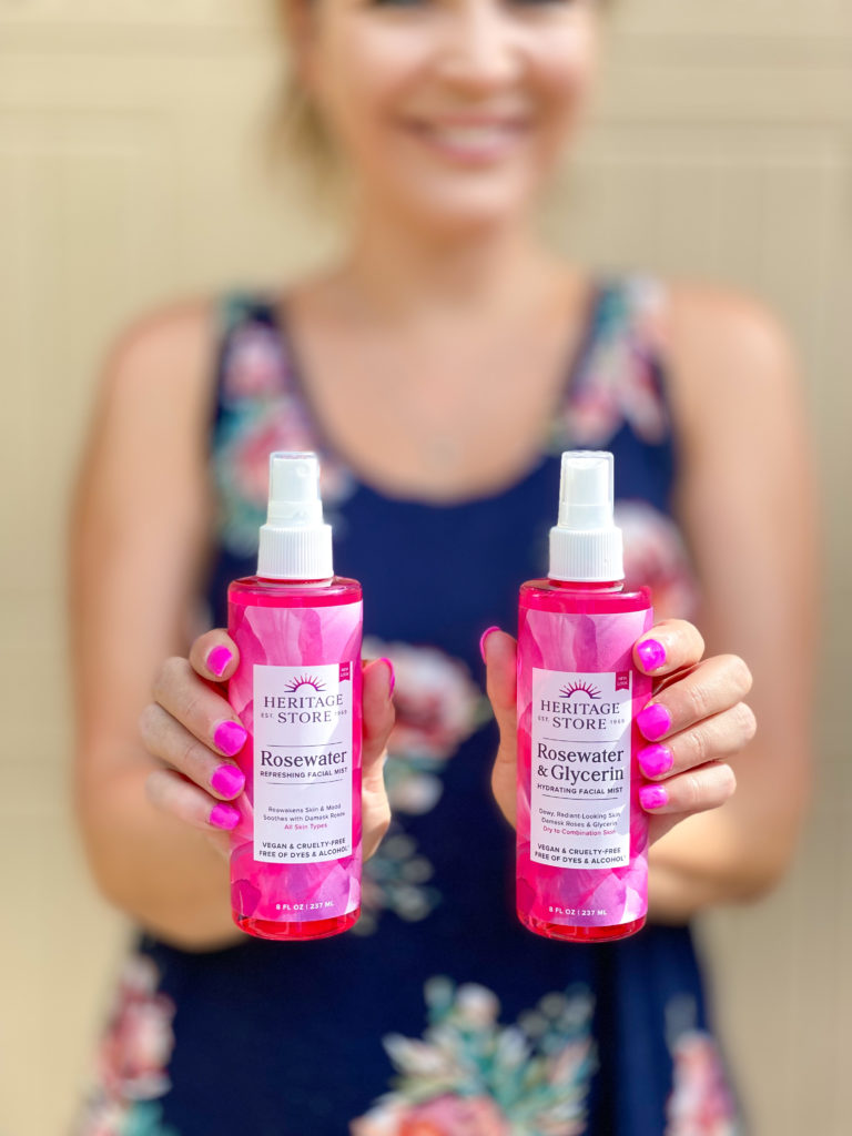 Heritage Store Rosewater bottles in womans hands